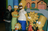 Boy hanging out with the Simpsons family