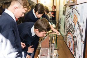 Students interact with the exhibits